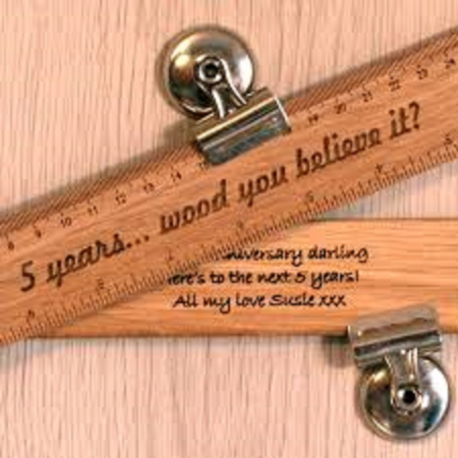 it's customized wooden rulers for fifth year anniversary