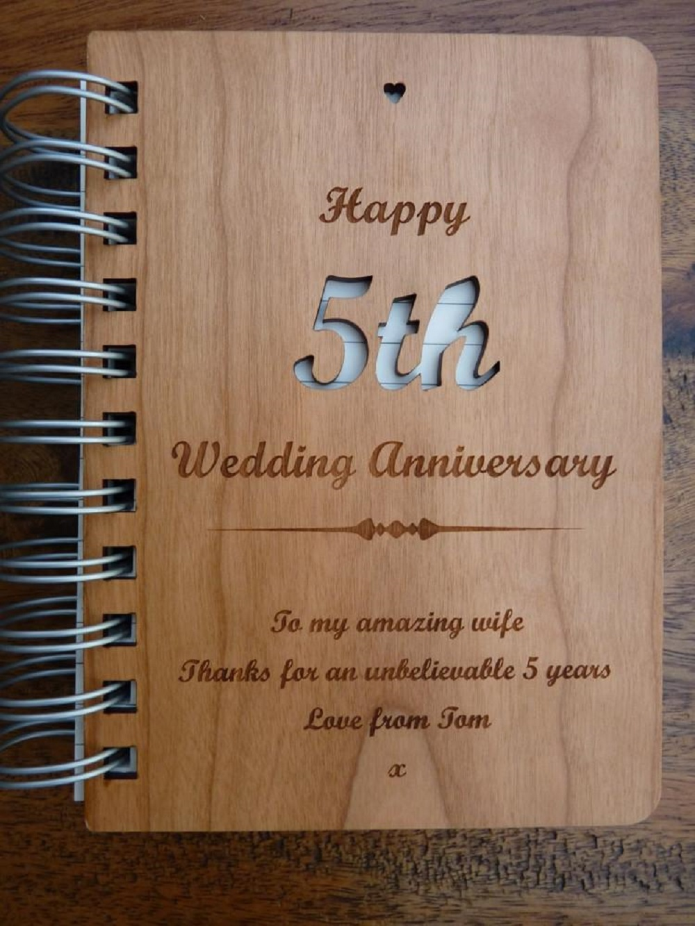 it's a journal with wooden beautifully crafted cover for a fifth wedding anniversary