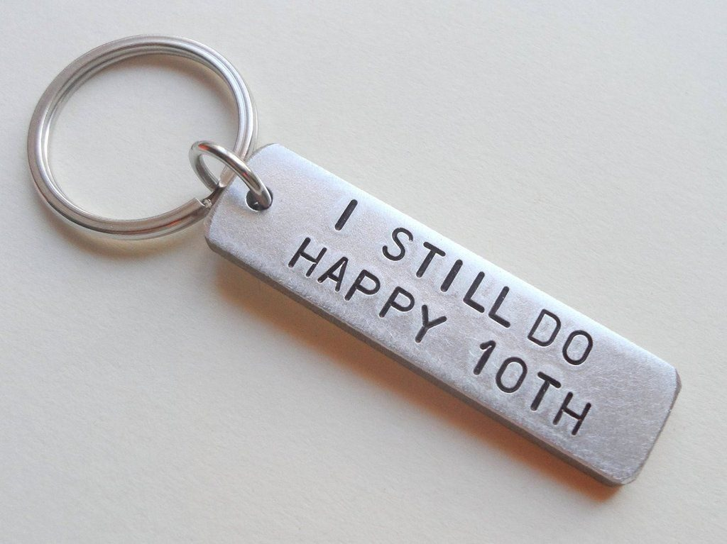 This is a key chain made from aluminium showing the tenth year wedding anniversary gift - traditional wedding gifts