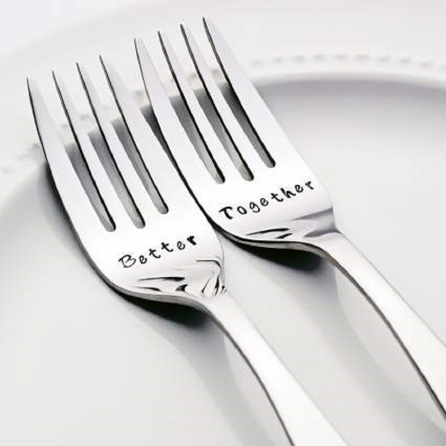 It's a personalized silver set of spoon and fork for 25th anniversary