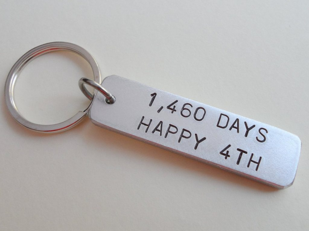 it's a picture of key chain showing 4 year wedding anniversary gift