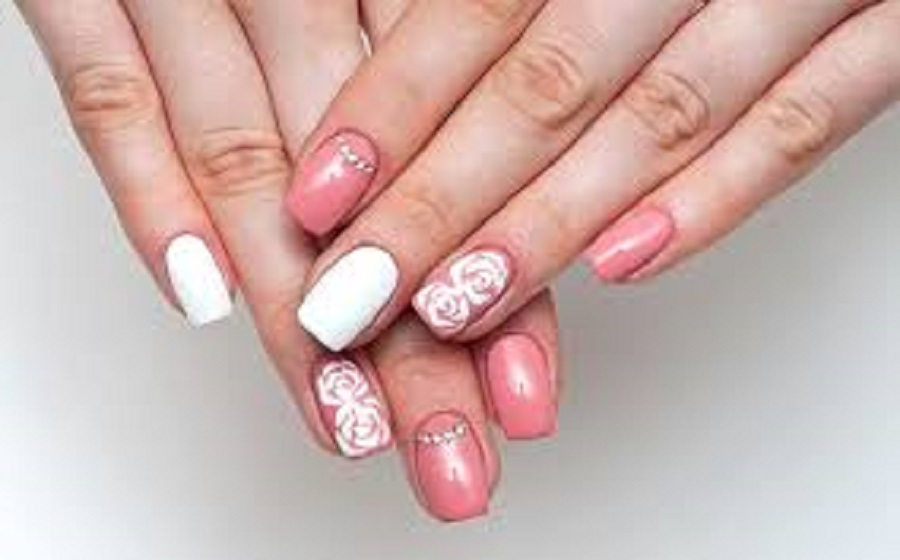 beautiful and cute wedding nail art design with flowery design