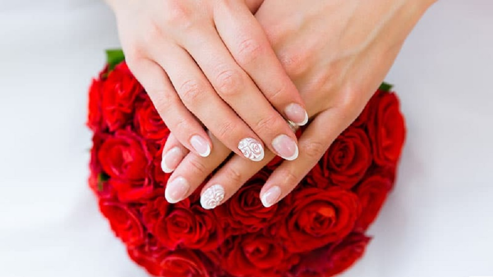 beutiful flowery design wedding nail art