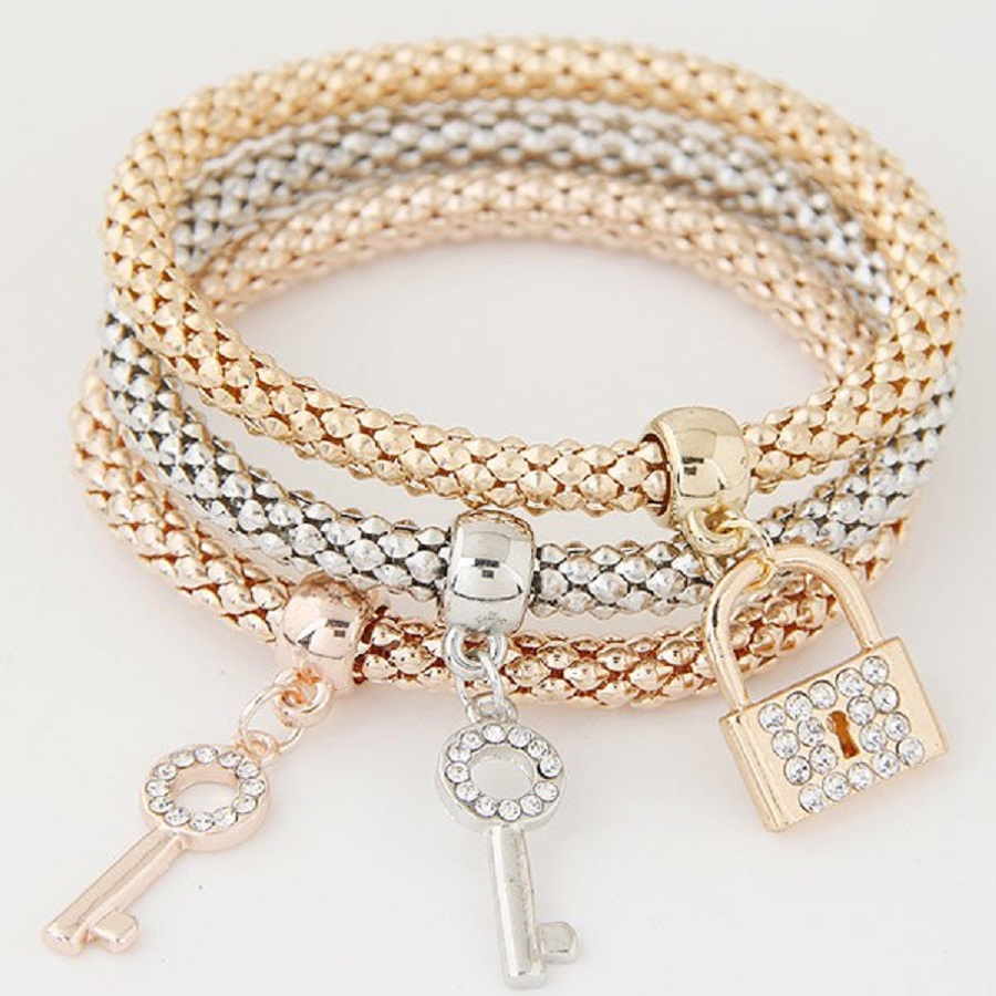 its' a picture showing lock and key charm bracelets for women