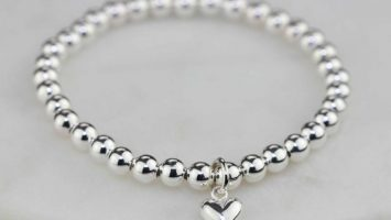 it's a picture of silver charm bracelets for women