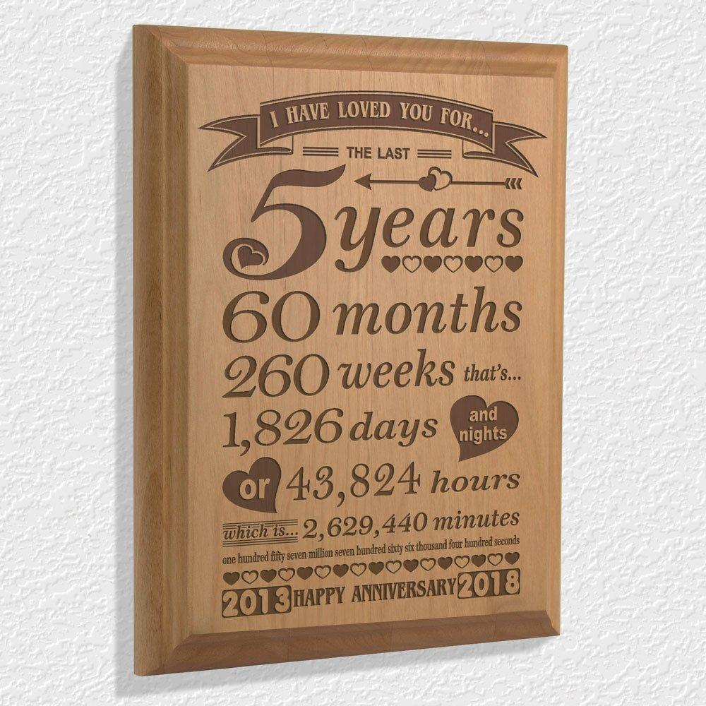 it's a quote about fifth year marriage written in wooden board as fifth year anniversary gift - traditional wedding gifts