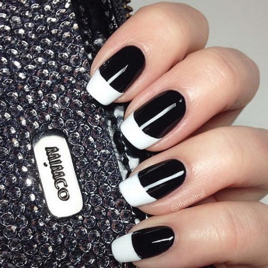 it's a picture of black and white design of simple nail art