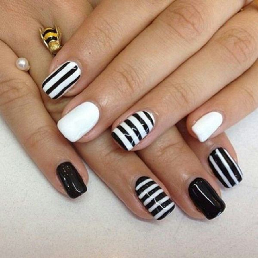 it's a picture of casual nail arts design with black and white vibe