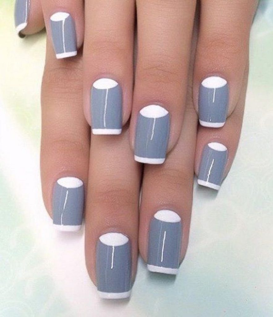 it's a picture of simple nail art with half-moon design