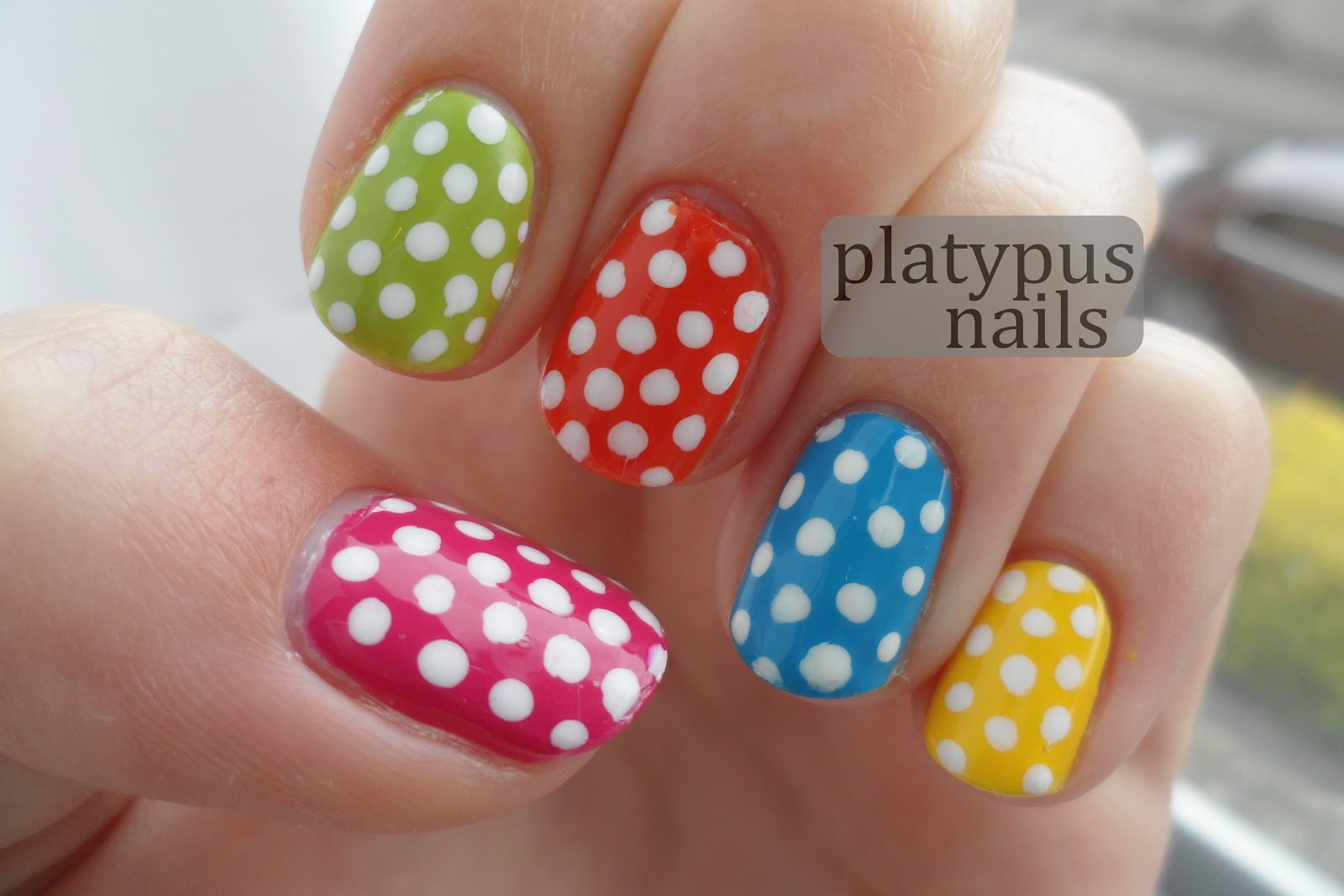 it's a picture of simple polka dots nail designs